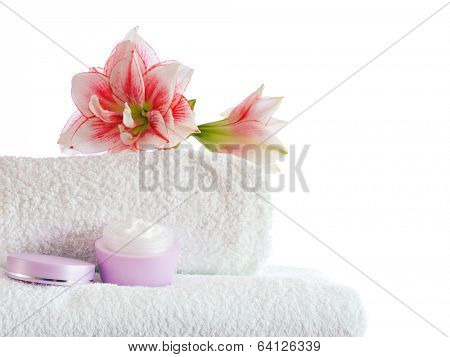 stacked white towels with pink flowers  isolated on white background