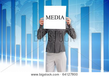 Businesswoman holding card saying media against global business graphic in blue