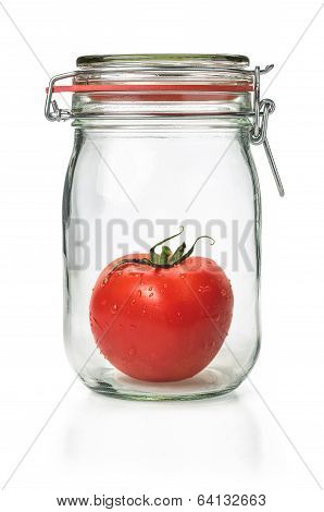 Fresh tomato in a canning jar on a white background