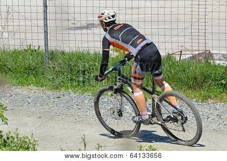 Cyclist Descends Downhill
