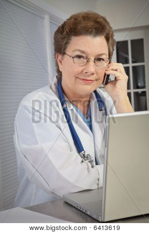 Woman Doctor Talking On Phone