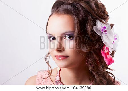 Portrait Of A Beautiful Brunette In The Spring Image With Flowers In Her Hair