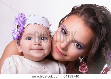 Beautiful Mother With Daughter Funny Smiling. Baby 6 Months