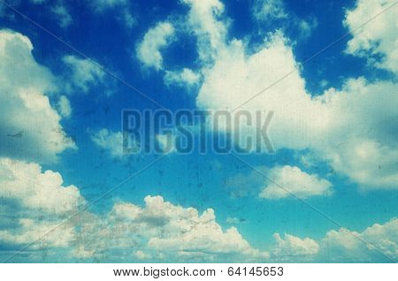 Blue sky with beautiful clouds sunny day. Filtered image: vintage, grunge and texture effects