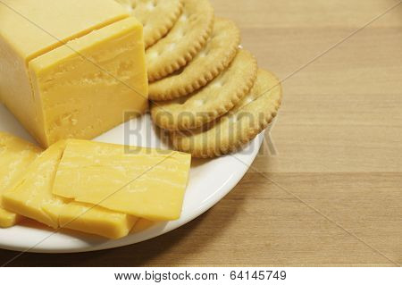 Cheddar Cheese And Crackers On Plate