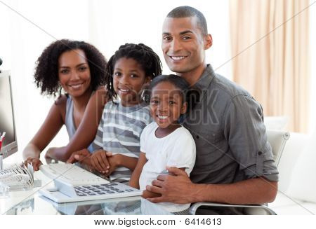 Happy Afro-american Family Working With A Computer At Home
