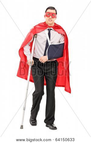 Male superhero with broken arm and a leg isolated on white background