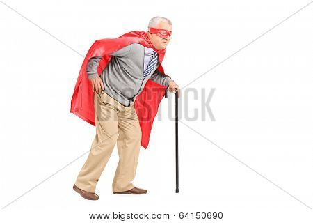 Senior with red cape and mask walking with cane isolated on white background