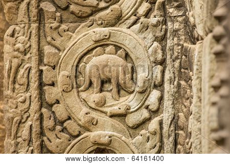 Stegosaurus bas-relief on the wall of Ta Prohm temple at Angkor Wat complex, Siem Reap, Cambodia