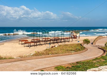 Walkway promenade along empty beach on Mediterranean sea in Ashkelon, Israel.