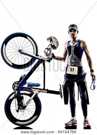 man triathlon iron man athlete standing with all his equipment in silhouettes on white background