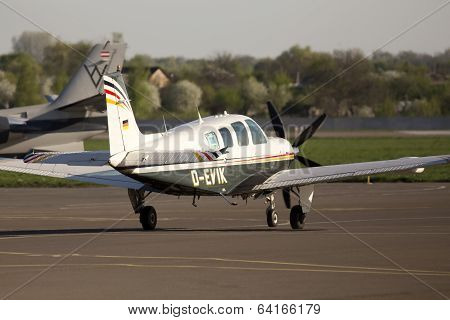 Beechcraft A36 Bonanza business aircraft running on the runway
