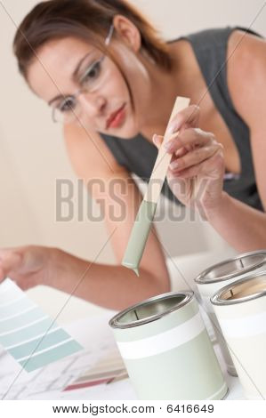 Female Designer With Can Of Paint