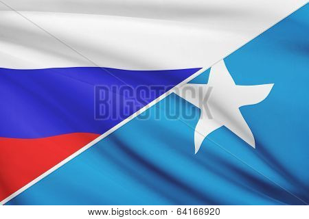 Series Of Ruffled Flags. Russia And Federal Republic Of Somalia.