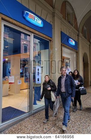 BOLOGNA, ITALY - APRIL 19, 2014: A pedestrian walks past a TIM (Telecom Italia Mobile) retail shop in Bologna, Italy, on Saturday, April 19, 2014.