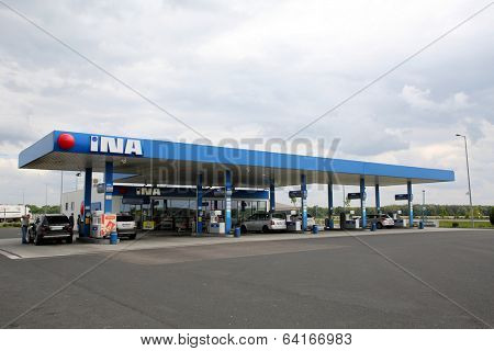SORMAS, HUNGARY - APRIL 21, 2014: Cars at an INA gas station  in Sormas, Hungary, on Monday, April 21, 2014. INA-Industrija nafte, d.d. is the state owned oil and fuel distributor in Croatia.
