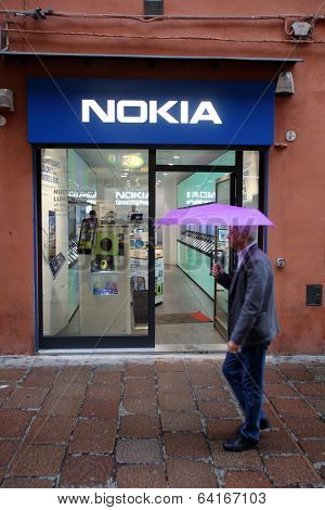 BOLOGNA, ITALY - APRIL 19, 2014: A man walks past a Nokia mobile telephone retail store in Bologna, Italy, on Saturday, April 19, 2014.