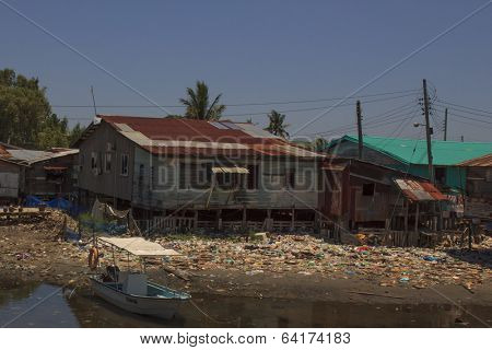 KOTA KINABALU, MALAYSIA - APRIL 26 2014: Plastic rubbish pollution in poor slum. Photo showing pollution problem of garbage thrown out with no proper trash collection or recycling.