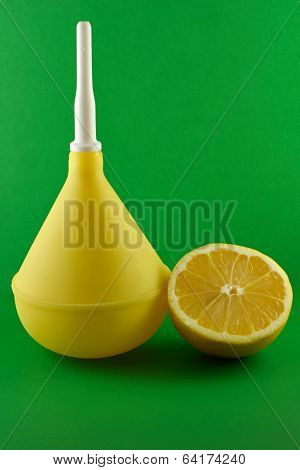 Medical Enema With Lemon On Green