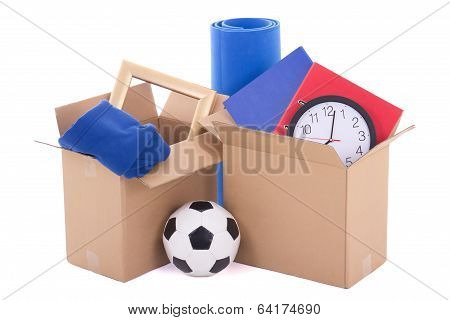 Moving Day Concept - Brown Cardboard Boxes With Stuff Isolated On White