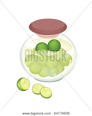 Preserved Limes In A Jar On White Background