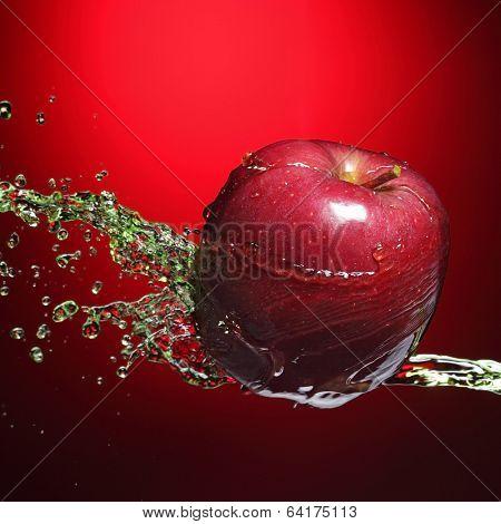 red apple in juice stream