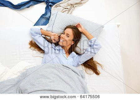 Woman Awake In Bed And Smiling