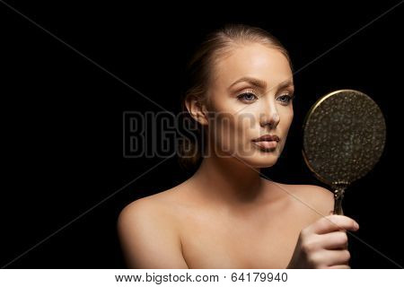 Sensual Female Model Looking In Make Up Mirror