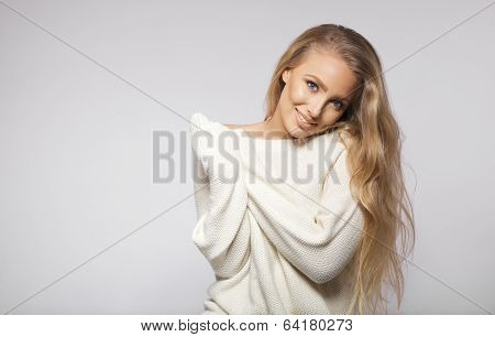 Stunning Young Blonde Posing On Grey Background