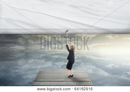 Composite image of businesswoman pulling a white screen over bridge over peaceful water