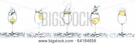 Lemon Splashing Into Glasses Of Water On White Background