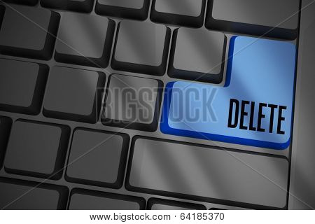 The word delete on black keyboard with blue key
