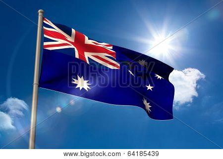 Australia national flag on flagpole on blue sky background