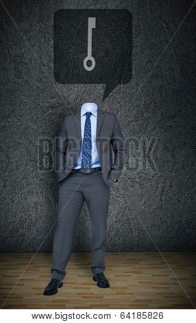Composite image of headless businessman with key in speech bubble in grey room