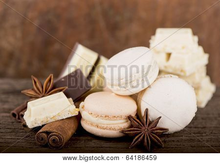 Chocolate macaroons with pieces of white and black chocolate