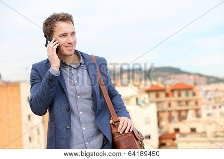 Man on smartphone - young business man talking on smart phone. Casual urban professional businessman using mobile cell phone smiling happy walking. Handsome man wearing suit jacket in Barcelona, Spain