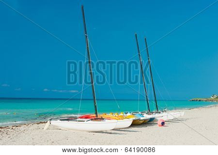 Sailing boats on the shore of Varadero beach in Cuba on a beautiful sunny day