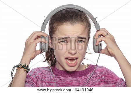 Desperate Teenage Girl Takes Off Her Headphones, Isolated On White