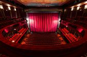 foto of cinema auditorium  - an old theater auditorium interior poor light - JPG