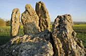 stock photo of burial  - The Whispering Knights Rollright Stones Neolithic Burial Chamber - JPG