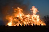 pic of bonfire  - People are watching a huge bonfire a tradition with easter in Nort - JPG