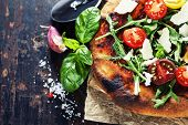 pic of rocket salad  - pizza and fresh italian ingredients on a dark background - JPG