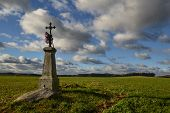 picture of calvary  - abandoned calvary middle of a field in autumn day - JPG