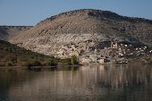 stock photo of euphrates river  - village on the shore of the Euphrates River in southern Turkey - JPG