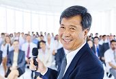stock photo of public speaking  - Asian Business Manager - JPG