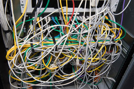 image of backspace  - A lot of cables for internet on the back of a big computer - JPG