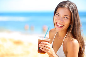 stock photo of cold drink  - Beach woman drinking cold drink beverage having fun at beach party - JPG