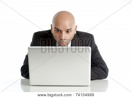 Businessman Typing On Computer Keyboard With Funny Face Expression