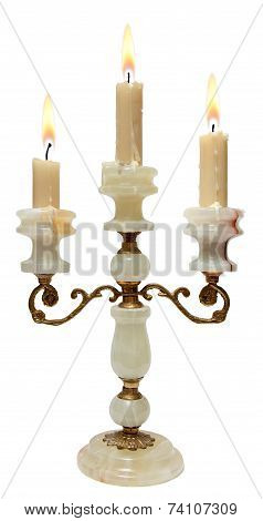 Burning Candle In Old Bronze With Onyx Candlestick Isolated  White Background.