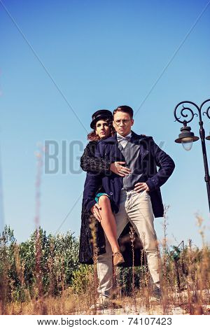 Two Fashion People In Vintage Style Posing In Below Shot
